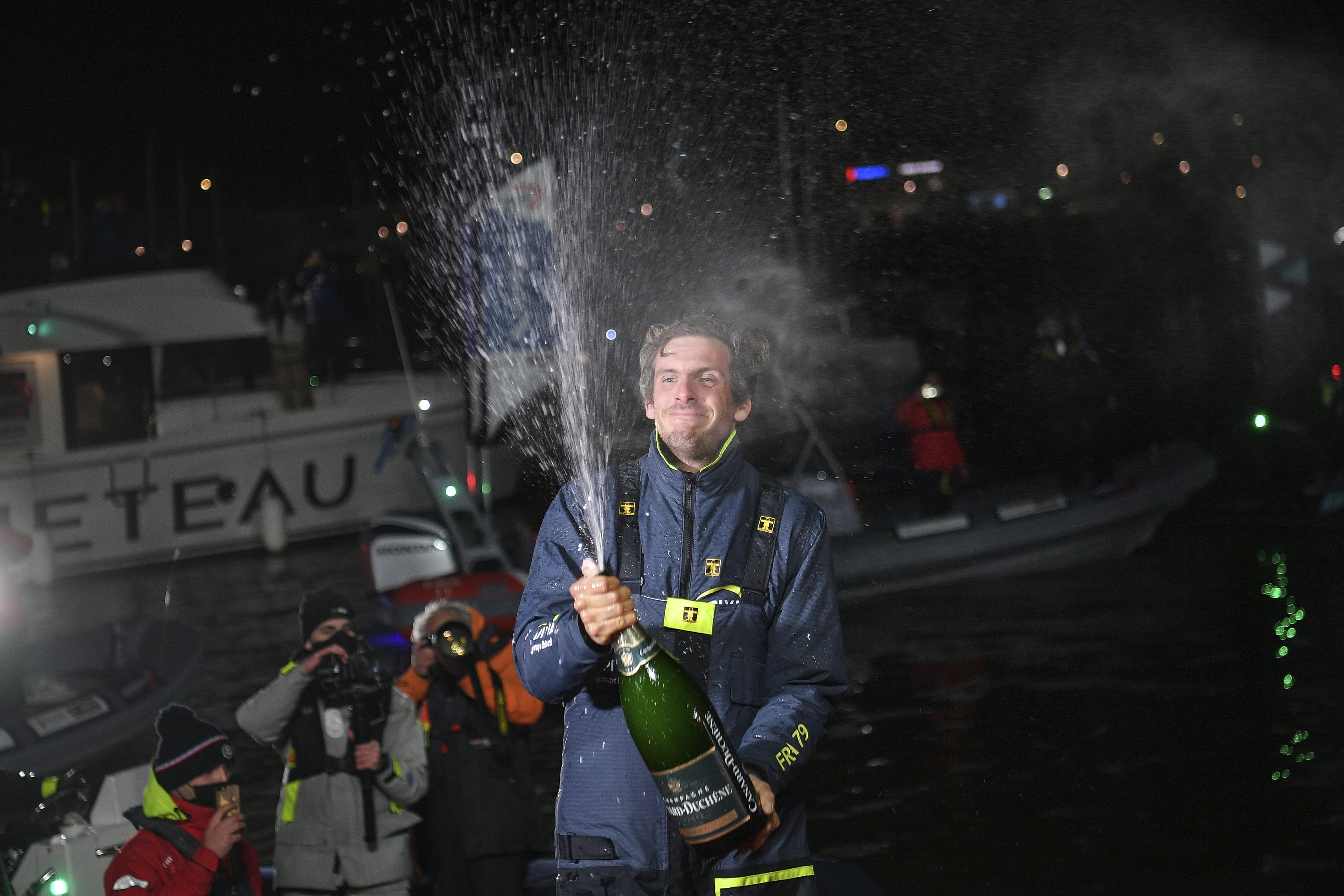 Dalin crosses line 1st in Vendee Globe yet unsure of victory