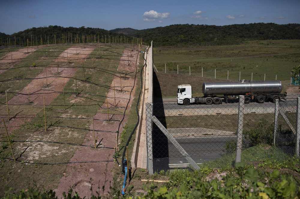 The overpass juts from a forest over a four-lane highway in a rural area outside Rio de Janeiro, Brazil