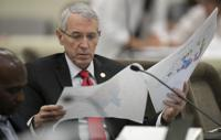 FILE - In this Sept. 12, 2019, file photo, state Rep. John Szoka, of Fayetteville, looks over a redistricting map during a committee meeting at the Legislative Office Building in Raleigh, N.C. After lawsuits alleging racial gerrymandering, Republicans drawing legislative redistricting maps in Texas, Ohio and North Carolina this year say they won't use racial or partisan data in making their determinations. (Robert Willett/The News & Observer via AP)