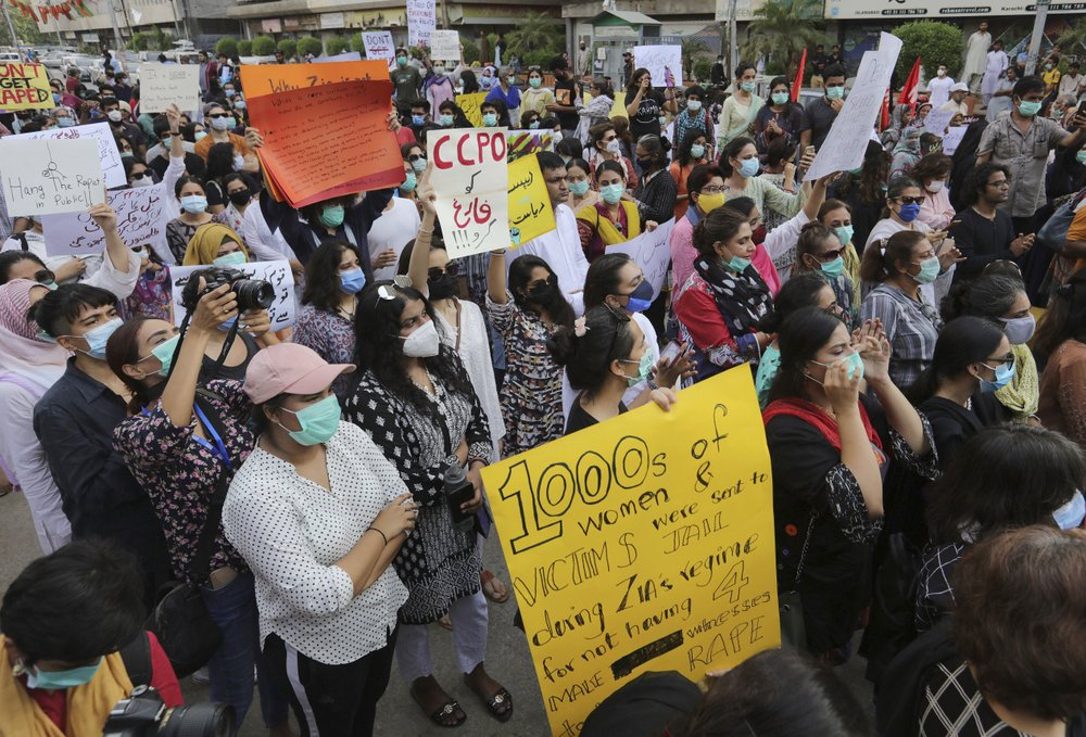 Members of civil society groups take part in a rally to condemn the incident of rape on a deserted highway, in Karachi, Pakistan, Saturday, Sept.  12, 2020. Pakistani police said they detained 15 people for questioning after two armed men allegedly gang raped a woman in front of her children after her car broke down on a deserted highway near the eastern city of Lahore.  (AP Photo/Fareed Khan)