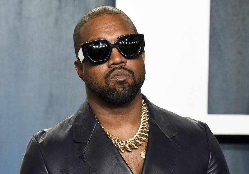 FILE - Kanye West arrives at the Vanity Fair Oscar Party in Beverly Hills, Calif., on Feb. 9, 2020. Kanye just wants to be Ye. Kanye West filed court documents Tuesday, Aug. 24, 2021, to legally change his name.  (Photo by Evan Agostini/Invision/AP, File)