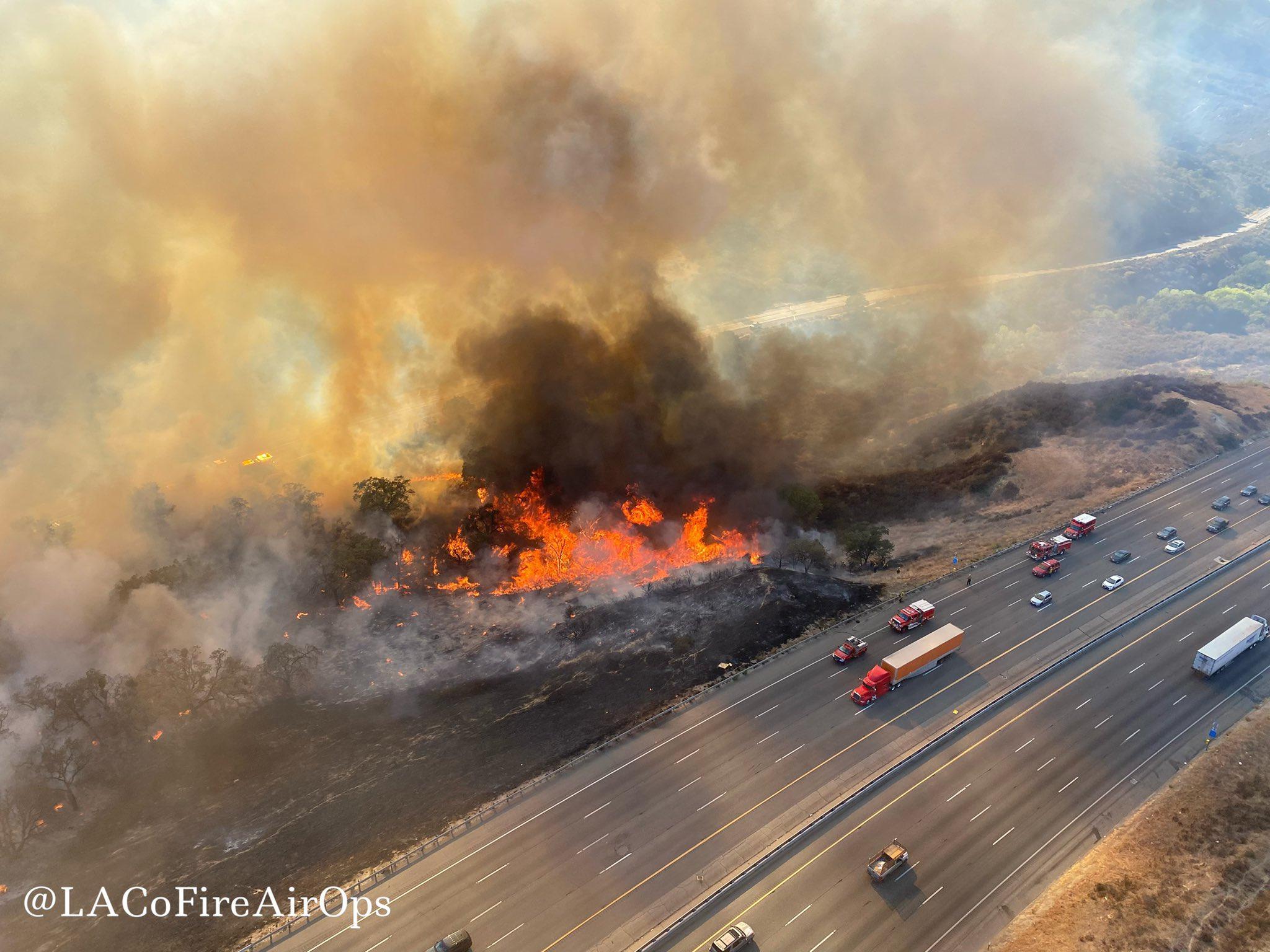 Firefighters advance on blaze that shut California highway