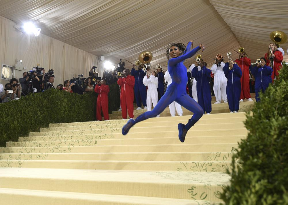 """Nia Dennis and the Brooklyn United marching band attend The Metropolitan Museum of Art's Costume Institute benefit gala celebrating the opening of the """"In America: A Lexicon of Fashion"""" exhibition on Monday, Sept. 13, 2021, in New York. (Photo by Evan Agostini/Invision/AP)"""