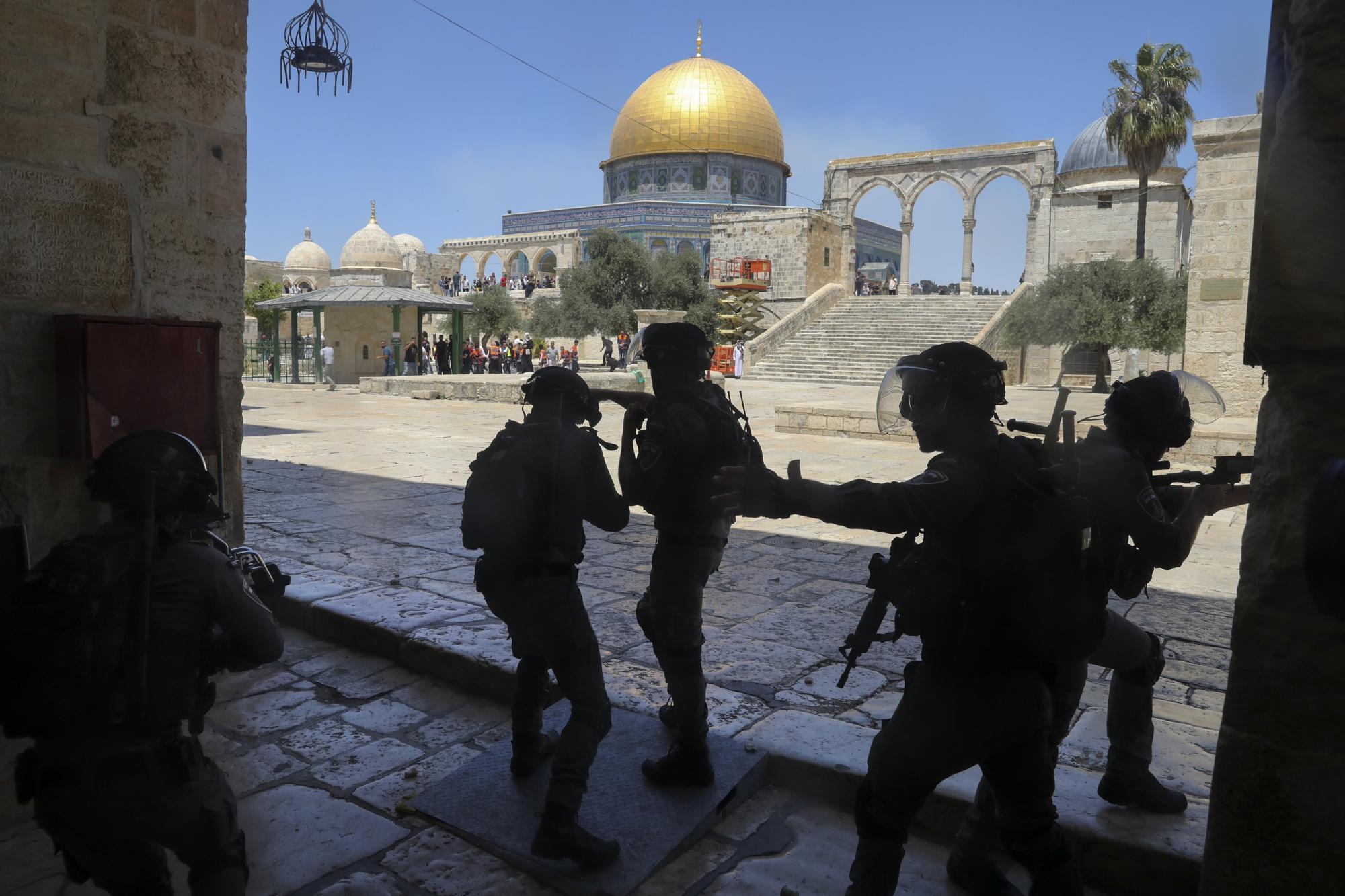 Israeli security forces take positions during clashes with Palestinians in front of the Dome of the Rock Mosque at the Al Aqsa Mosque compound in Jerusalem's Old City, Friday, June 18, 2021. (AP Photo/Mahmoud Illean)
