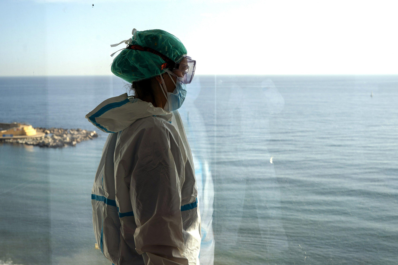 AP Photos: Spanish nurses witness grim solitude of COVID-19