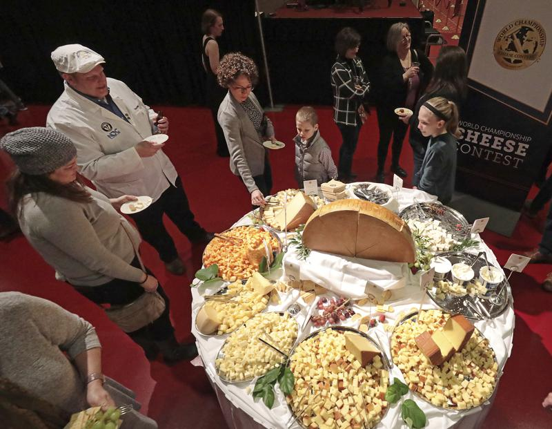 FILE - In this March 5, 2020 file photo, visitors to the Cheese Champion event of the World Championship Cheese Contest sample offerings from an array of international producers during the gathering at Monona Terrace in Madison, Wis. A bill being heard by a state Assembly committee would make colby, which was created in Wisconsin more than 100 years ago, the official stage cheese. (John Hart/Wisconsin State Journal via AP, File)