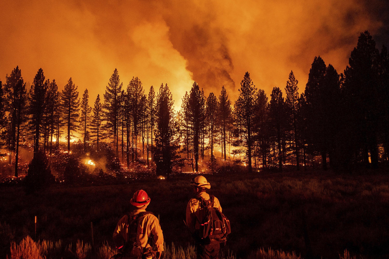 Heat, wind spur California fire; evacuation hits Nevada area