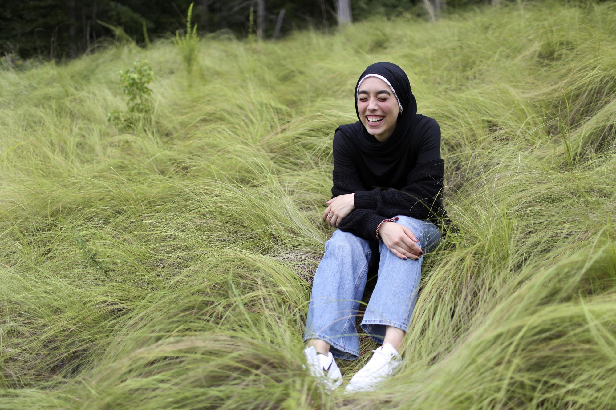 Amirah Ahmed, 17, outside of her home in Fredericksburg, Va., on Sunday, Aug. 15, 2021. Born after the 9/11 attacks, Ahmed feels she was thrust into a struggle not of her making. After 9/11, many young American Muslims have found ways to fight back against bias, to organize and craft nuanced personal narratives about their identities. (AP Photo/Jessie Wardarski)