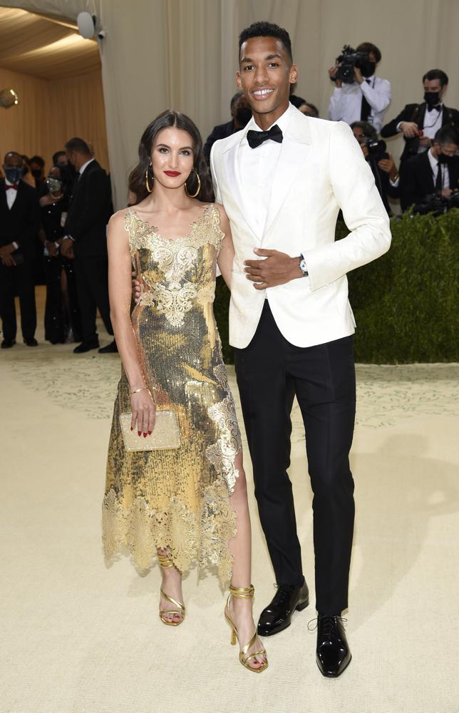 """Nina Ghaibi, left, and Felix Auger Aliassime attend The Metropolitan Museum of Art's Costume Institute benefit gala celebrating the opening of the """"In America: A Lexicon of Fashion"""" exhibition on Monday, Sept. 13, 2021, in New York. (Photo by Evan Agostini/Invision/AP)"""