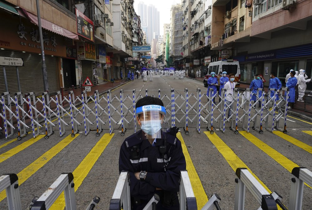 Thousands of Hong Kongers locked down to control coronavirus