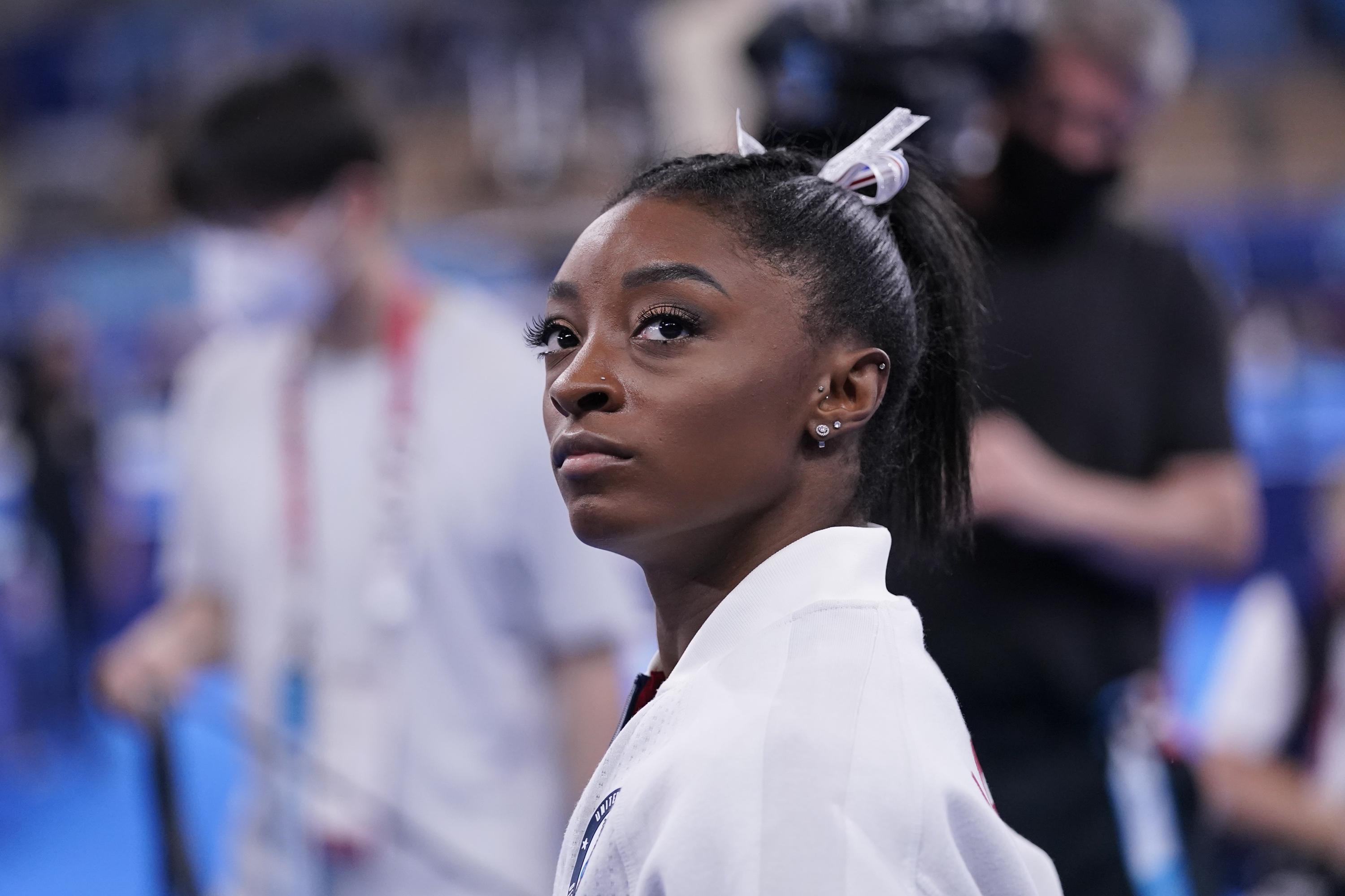 Olympic champ Biles out of team finals with apparent injury - Associated Press
