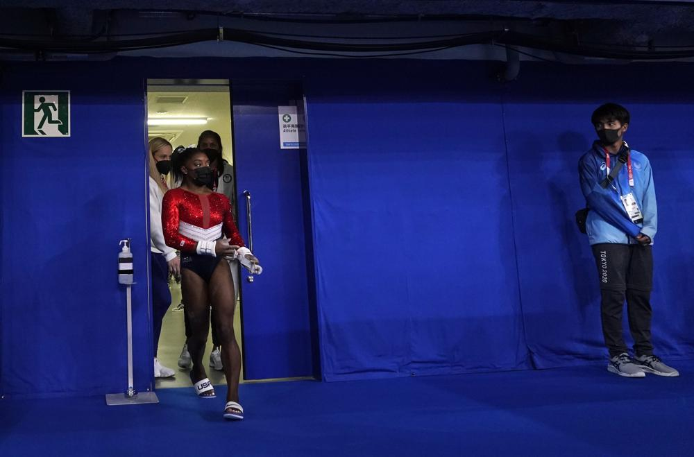 Simone Biles, of the United States, enters the court for the artistic gymnastics women's final at the 2020 Summer Olympics, Tuesday, July 27, 2021, in Tokyo. (AP Photo/Gregory Bull)