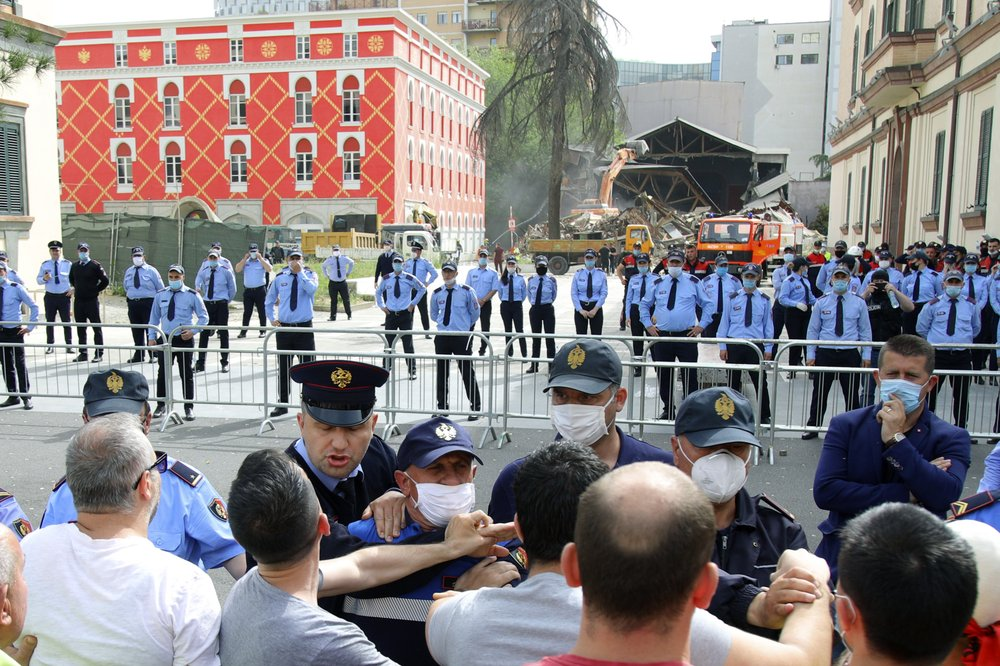 Albanian police pull protesting artists and others away from crumbling National Theater building