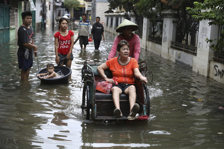 60 dead in landslides, flash floods in Indonesia's capital