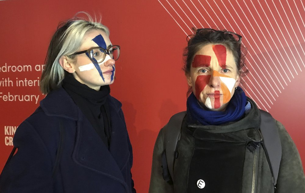 "Artists paint their faces with random geometric shapes as a means to provoke discussion of facial recognition technology which they see as ""rampant surveillance"""