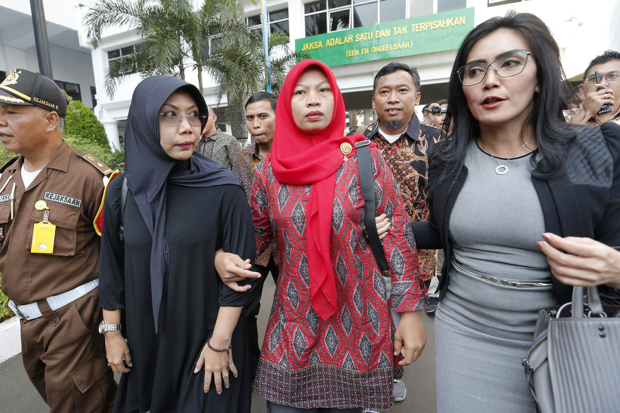 Indonesian who recorded her harasser gets reprieve from jail