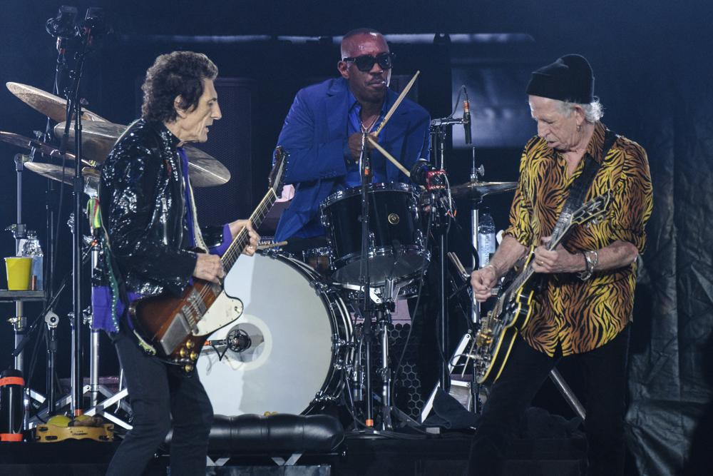 """Ronnie Wood, from left, Steve Jordan and Keith Richards of the Rolling Stones perform during the """"No Filter"""" tour at The Dome at America's Center, Sunday, Sept. 26, 2021, in St. Louis. (Photo by Amy Harris/Invision/AP)"""