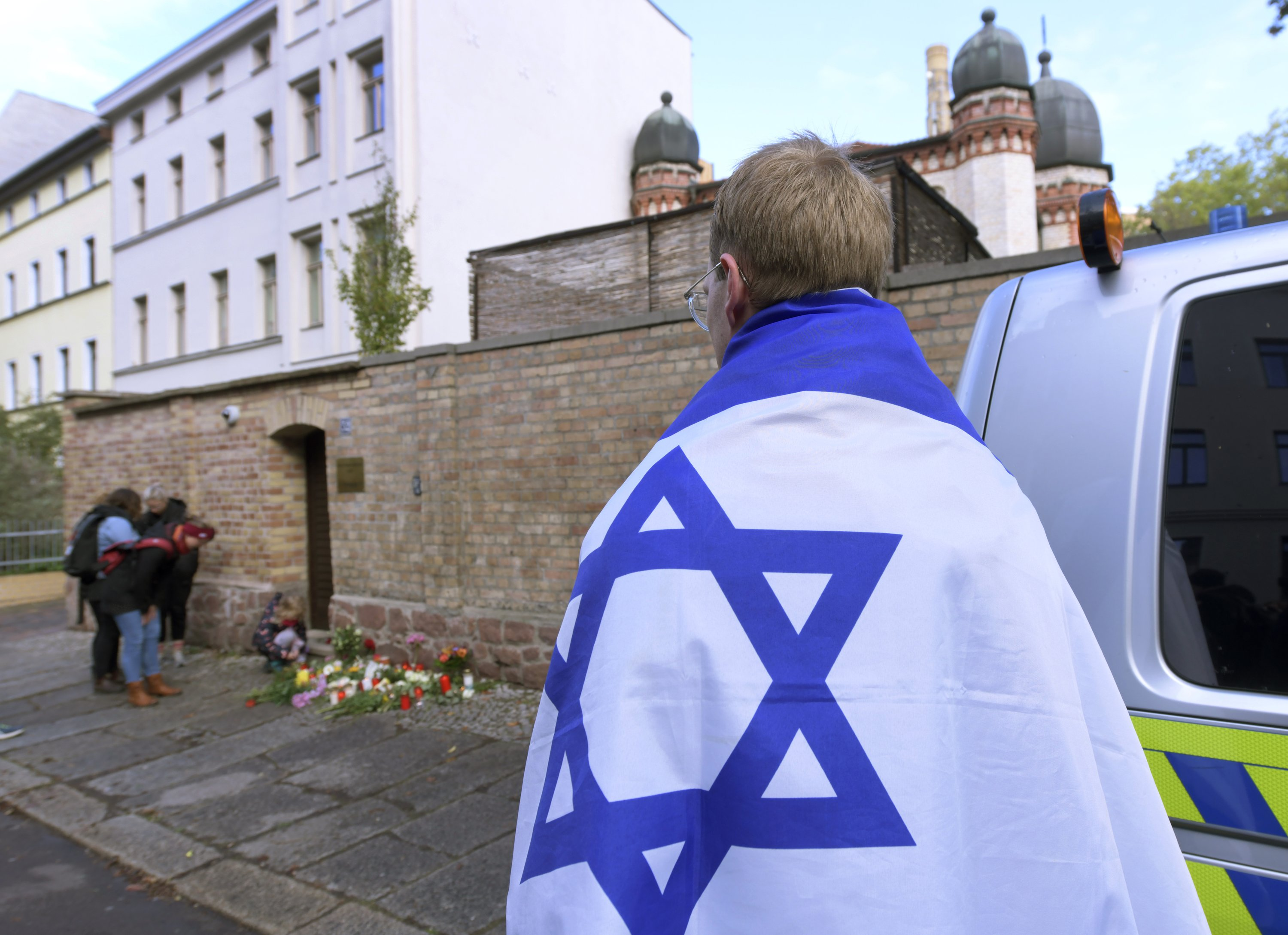 Germany seeks to reassure rattled Jews after holy day attack