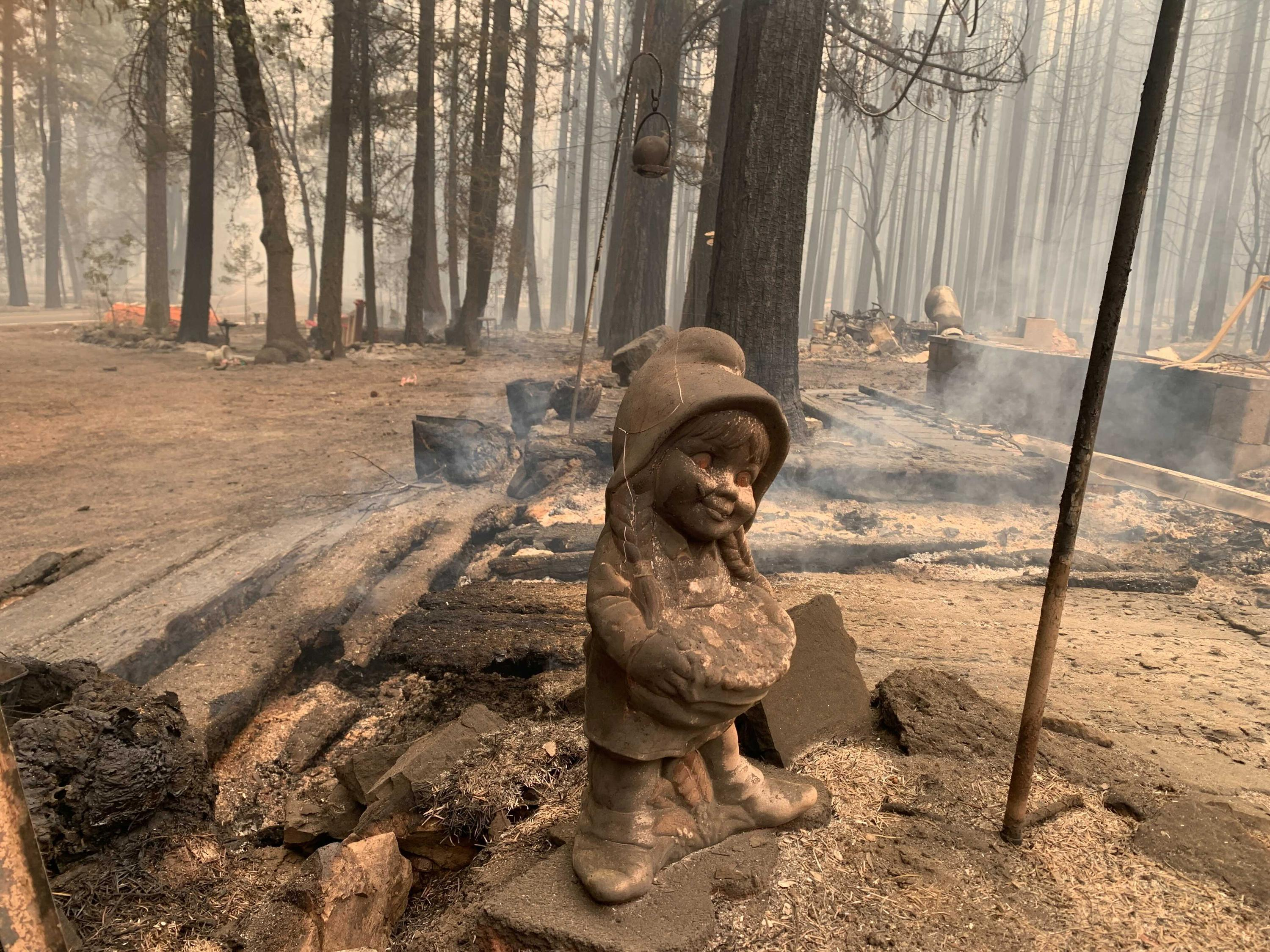 QUINCY, Calif. (AP) — Firefighters battling flames in Northern California forests girded Monday for new bouts of windy weather, and a utility warned