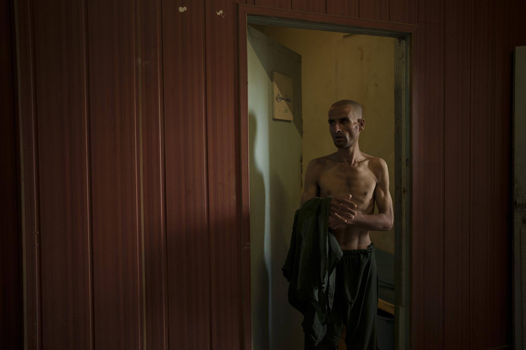 Taliban invokes Islam to weed out drugs from Afghanistan war begins with shaved heads for addicts