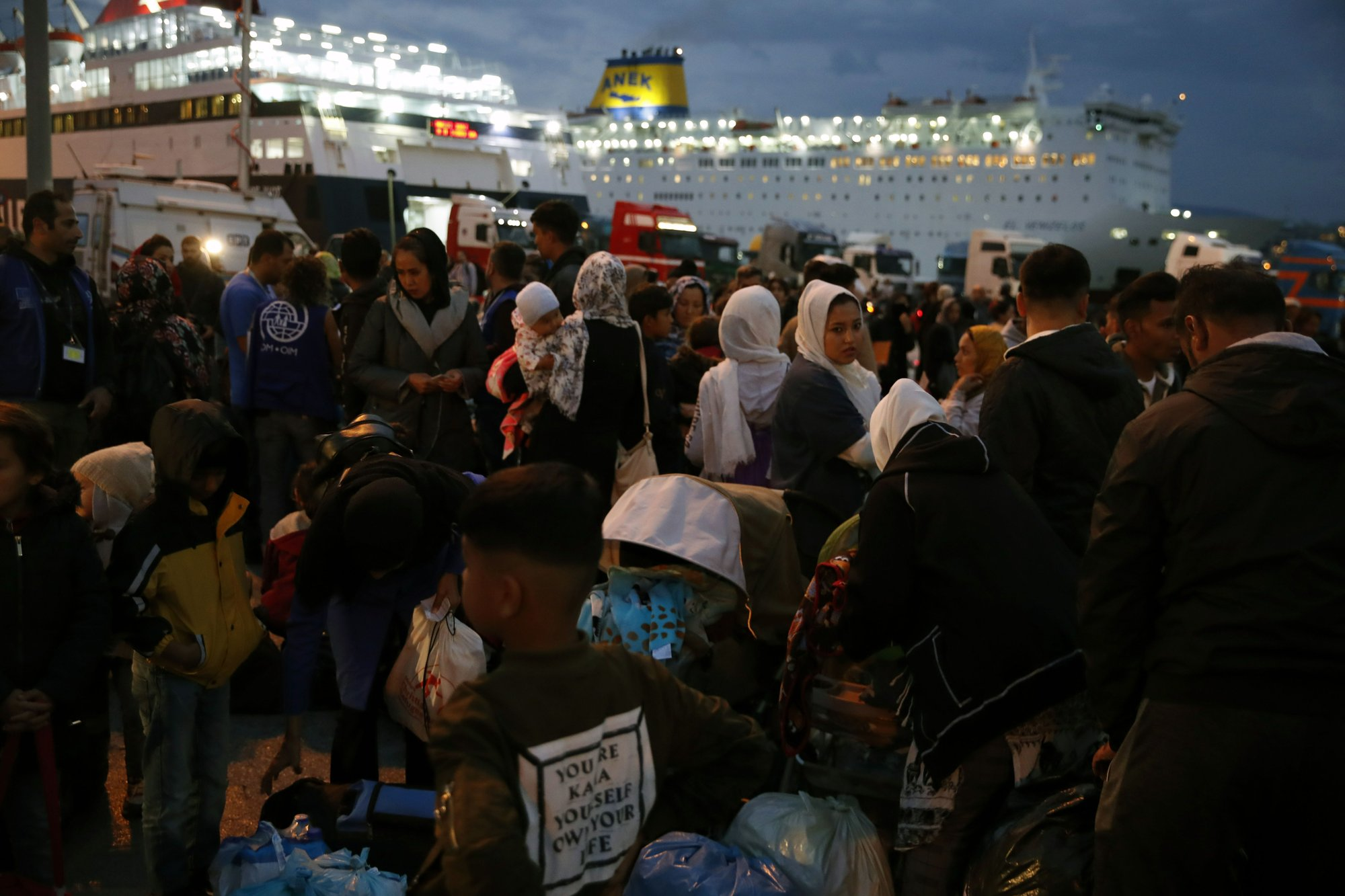 With eye on Syria, Greece expands refugee transfers