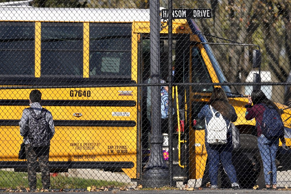 With COVID-19 cases and hospitalizations surging, schools suspend in-person education