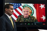 FILE - In this Aug. 30, 2021, file photo Gen. Frank McKenzie, Commander of U.S. Central Command, appears on screen as he speaks from MacDill Air Force Base, in Tampa, Fla., as he speaks about Afghanistan during a virtual briefing moderated by Pentagon spokesman John Kirby at the Pentagon in Washington. The Pentagon retreated from its defense of a drone strike that killed multiple civilians in Afghanistan last month, announcing Friday, Sept. 17, that an internal review revealed that only civilians were killed in the attack, not an Islamic State extremist as first believed. (AP Photo/Manuel Balce Ceneta, File)