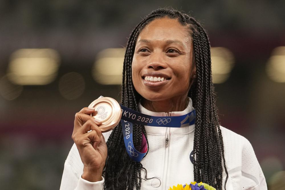 Bronze medalist Allyson Felix, of the United States, poses during the medal ceremony for the women's 400-meter run at the 2020 Summer Olympics, Friday, Aug. 6, 2021, in Tokyo. (AP Photo/Martin Meissner)
