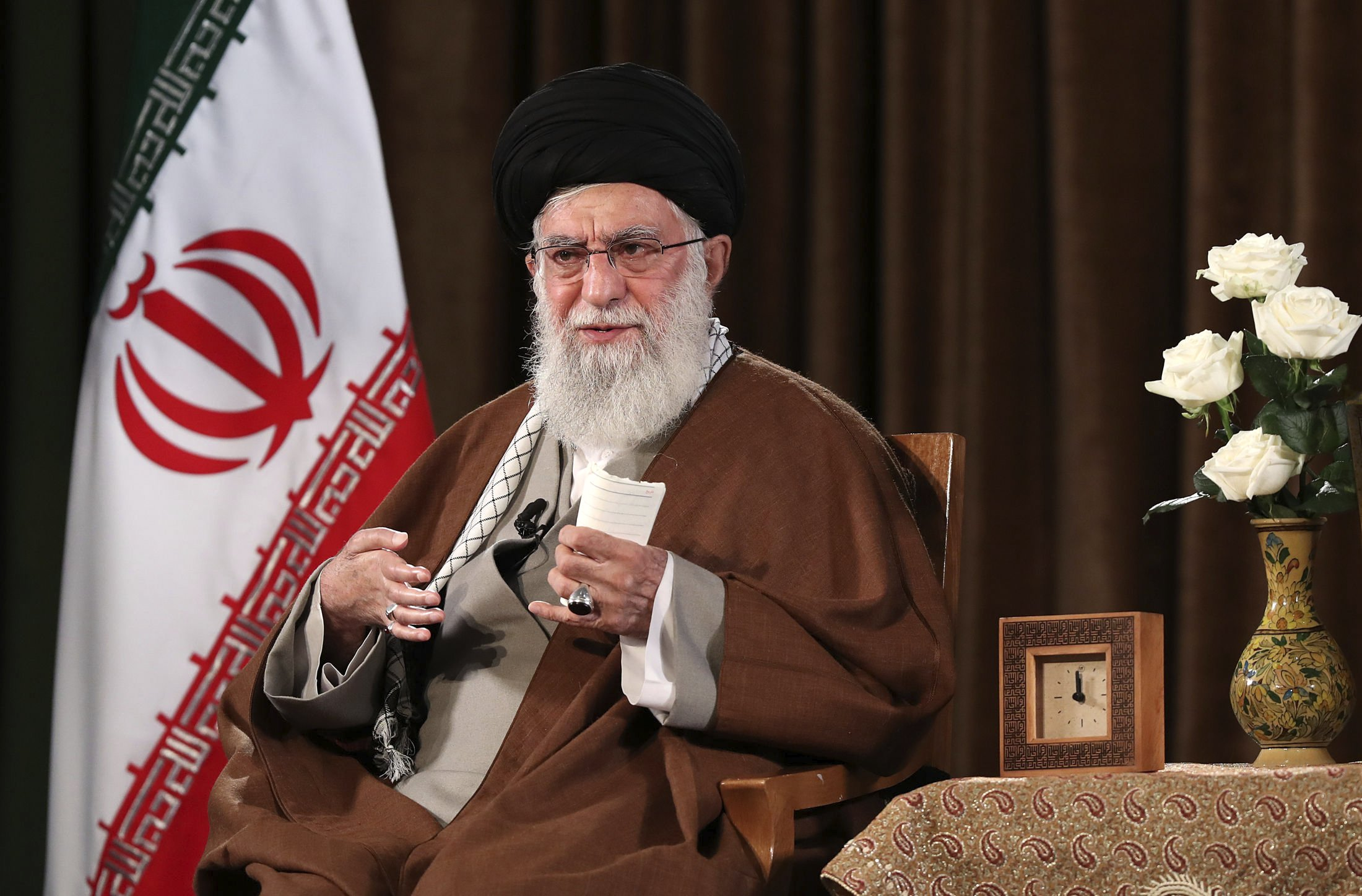 Image result for Iran leader refuses US help, citing virus conspiracy theory