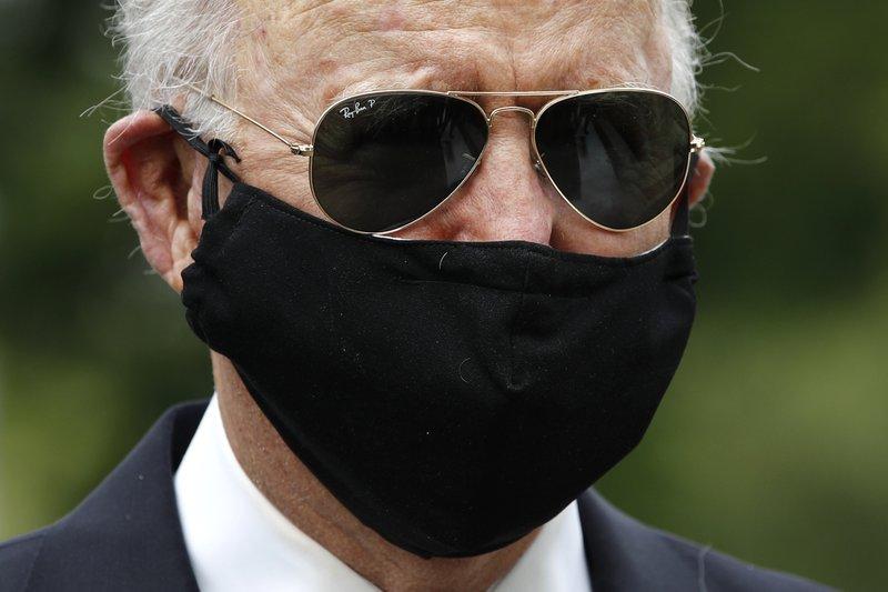 Biden knocks Trump for 'this macho stuff' in shunning masks