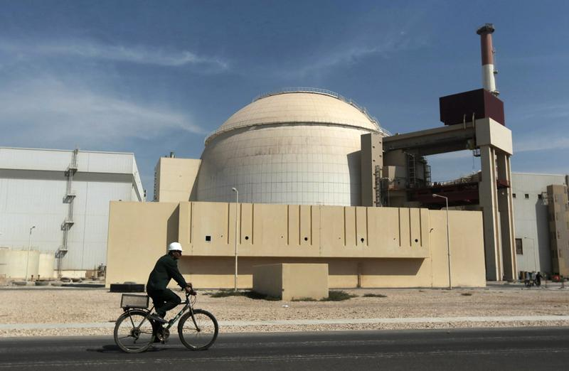 """FILE - In this Oct. 26, 2010 file photo, a worker rides a bicycle in front of the reactor building of the Bushehr nuclear power plant, just outside the southern city of Bushehr. Iran's sole nuclear power plant has undergone a temporary emergency shutdown, state TV reported on Sunday, June 20, 2021. An official from the state electric energy company, Gholamali Rakhshanimehr, said on a talk show that the Bushehr plant shutdown began on Saturday and would last """"for three to four days."""" (AP Photo/Mehr News Agency, Majid Asgaripour, File)"""