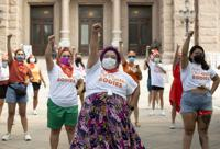 FILE - In this Wednesday, Sept. 1, 2021 file photo, Barbie H. leads a protest against the six-week abortion ban at the Capitol in Austin, Texas. Dozens of people protested the abortion restriction law that went into effect Wednesday. (Jay Janner/Austin American-Statesman via AP, File)
