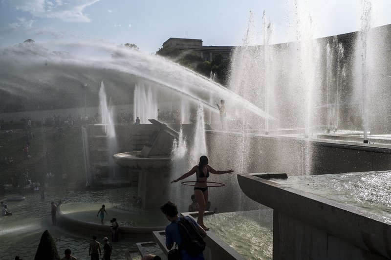 The Latest: Heat wave smashes weather records in Europe