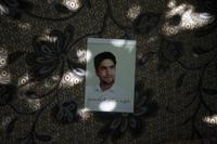 A portrait of Fida Mohammad, a 24-year-old dentist, who died after falling from a departing U.S. Air Force C-17 on Aug. 16, hangs in his family house in Kabul, Afghanistan, Friday, Sept. 17, 2021. (AP Photo/Felipe Dana)