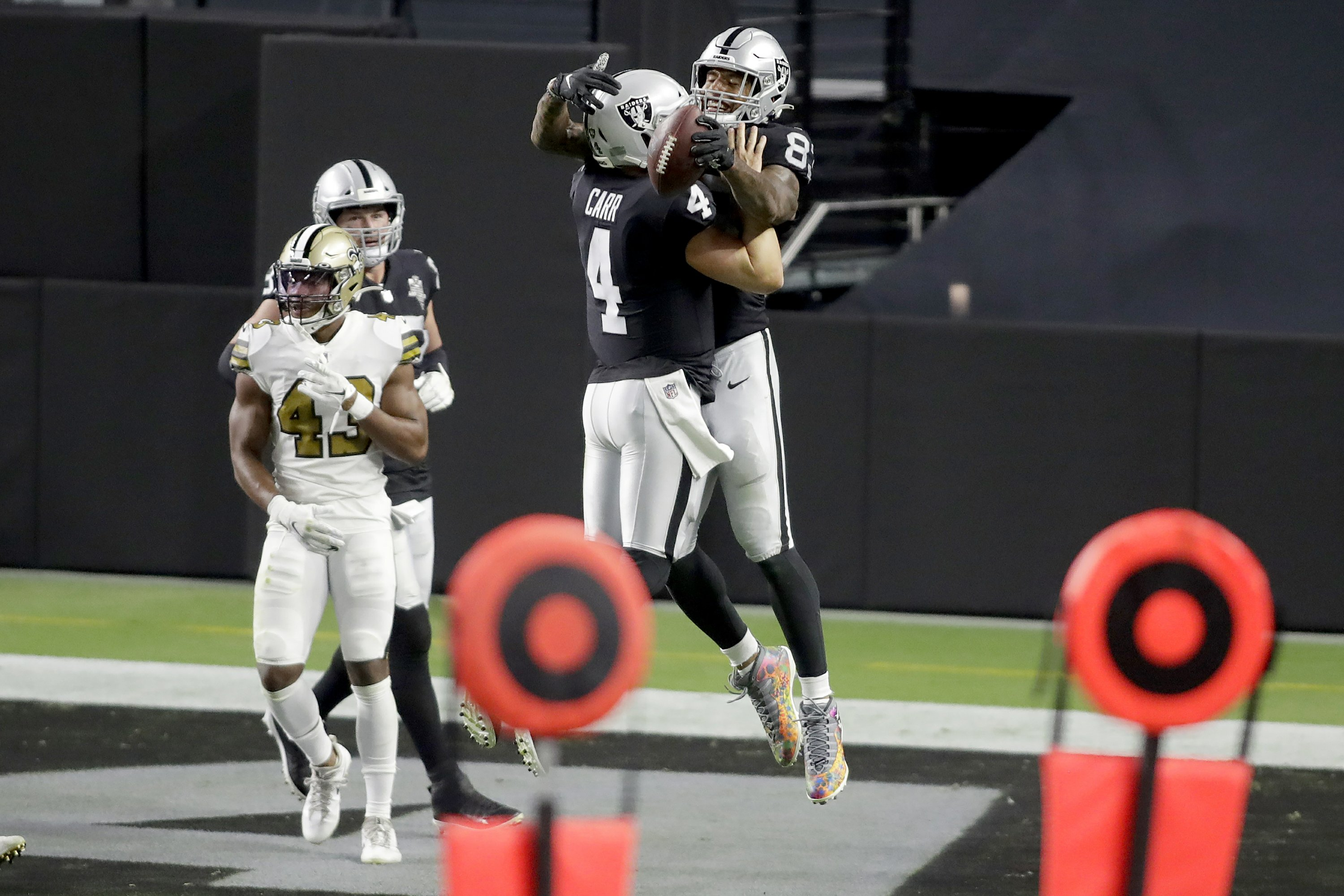 Raiders open Las Vegas stadium with 34-24 win vs Saints