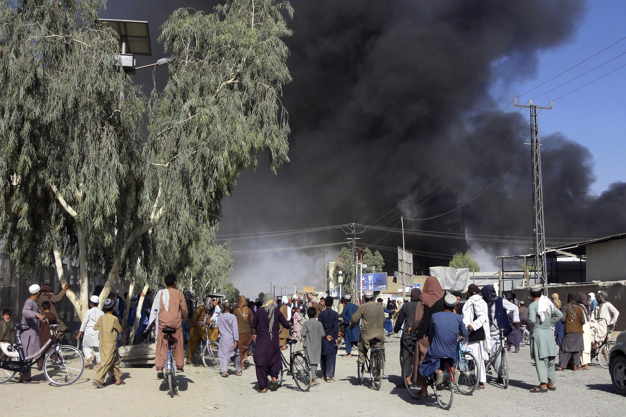 Plumes of smoke rise into the sky after fighting between the Taliban and Afghan security personnel in Kandahar, Afghanistan, southwest of Kabul, on Thursday, Aug. 12, 2021. (AP Photo/Sidiqullah Khan)