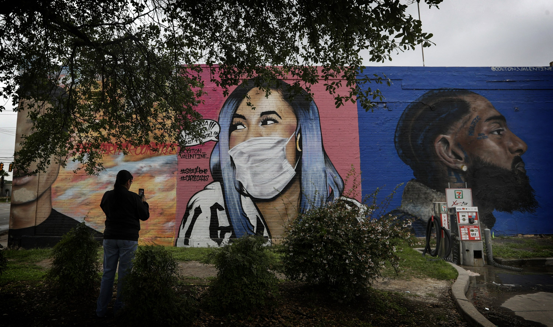 AP PHOTOS: Street art offers beauty, a laugh, some hope