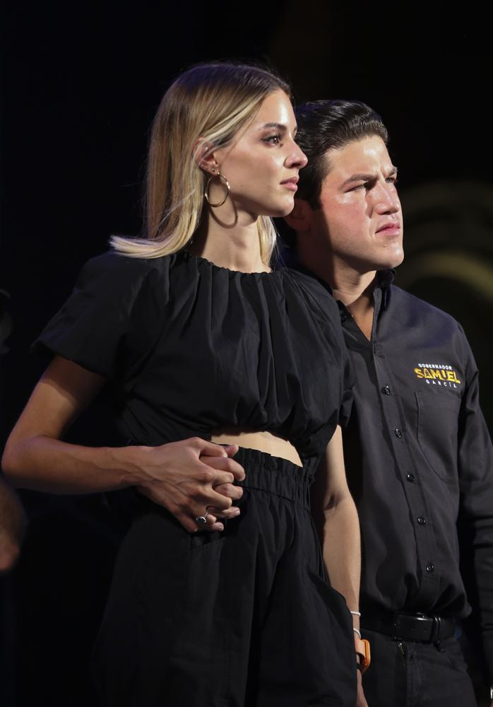 YouTuber Mariana Rodríguez and Samuel Garcia, the newly-elected governor of Nuevo Leon, attend their victory celebration at the Macroplaza of Monterrey, in Nuevo Leon state, Mexico, Monday, June 7, 2021. The apparent winner of the race, Samuel Garcia, 33, is a baby-faced former senator whose blond wife, YouTuber Mariana Rodríguez, is better known for posting videos of herself giving makeup tutorials or clutching a small dog. (AP Photo/Roberto Martinez)