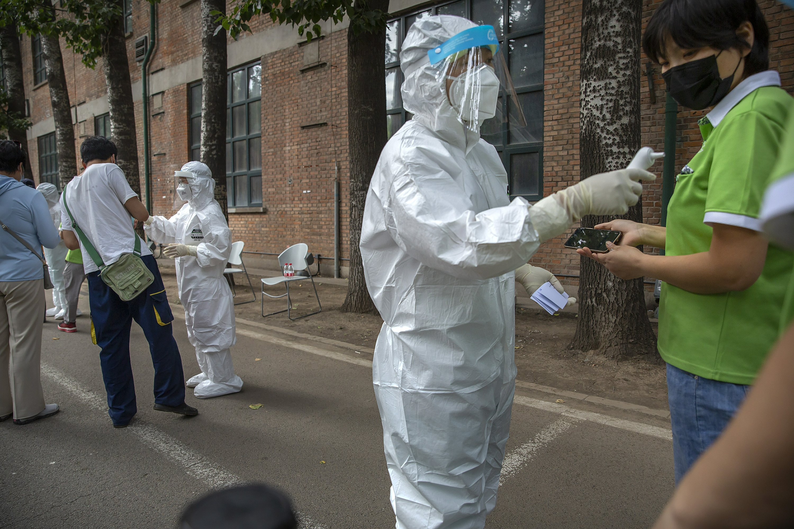 AP PHOTOS: A first-person view inside Beijing's virus tests thumbnail