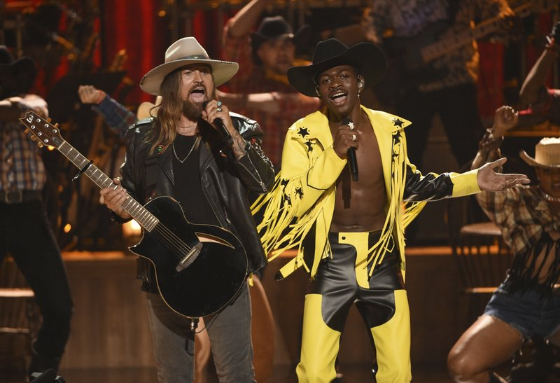 Billy Ray Cyrus, left, and Lil Nas X perform