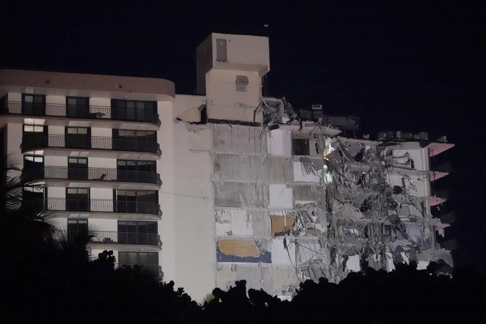 A partially collapsed building is seen early Thursday, June 24, 2021, in the Surfside area of Miami, Fla. A partial building collapse in Miami caused a massive response early Thursday from Miami Dade Fire Rescue, according to a tweet from the department's account. Miami Dade Fire Rescue is conducting search and rescue. Authorities had no word yet on casualties, or details of how many people lived in the building. (AP Photo/Wilfredo Lee)