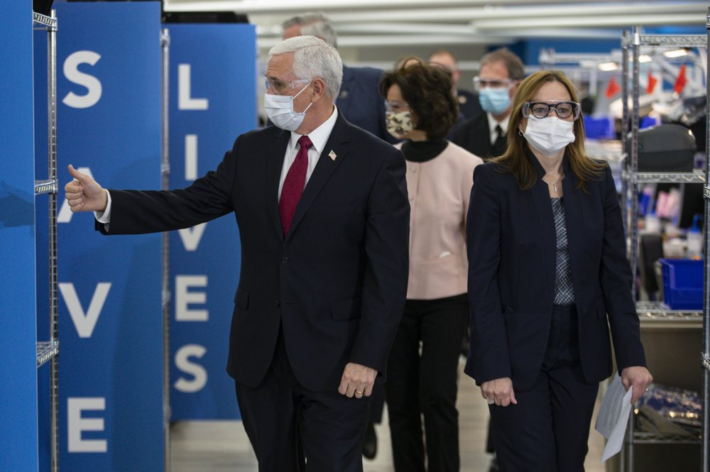 Vice President Mike Pence donned a face covering as he toured a General Motors/Ventec ventilator production facility in Indiana