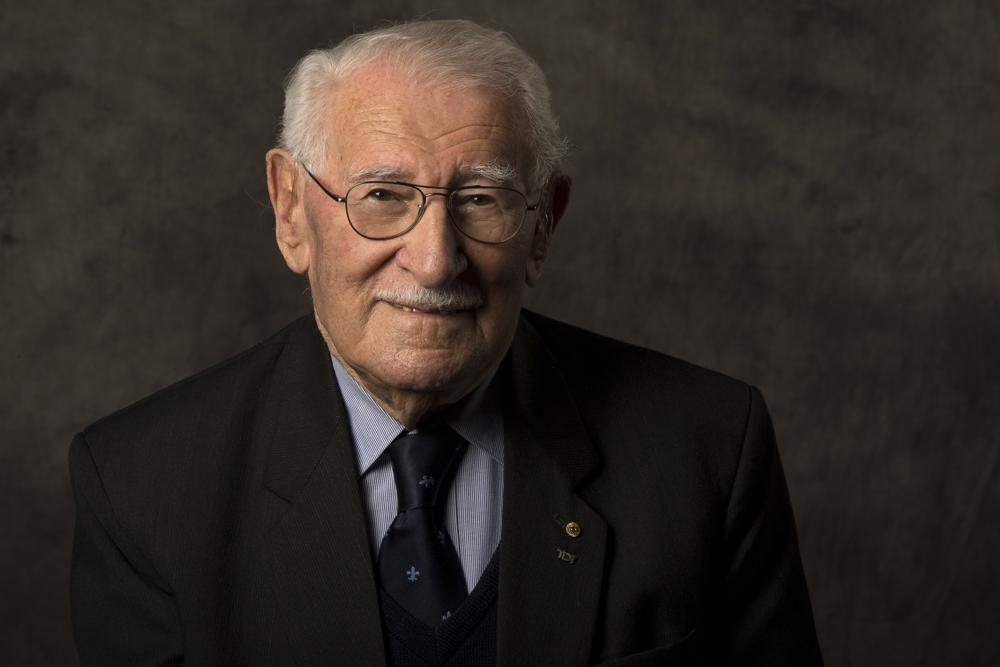 """In this undated photo provided by the Sydney Jewish Museum, Holocaust survivor Eddie Jaku poses for a photograph in Sydney, Australia. Jaku, who last year published his best-selling memoir, """"The Happiest Man on Earth,"""" has died in Sydney, a Jewish community leader said. He was 101. (Sydney Jewish Museum via AP)"""