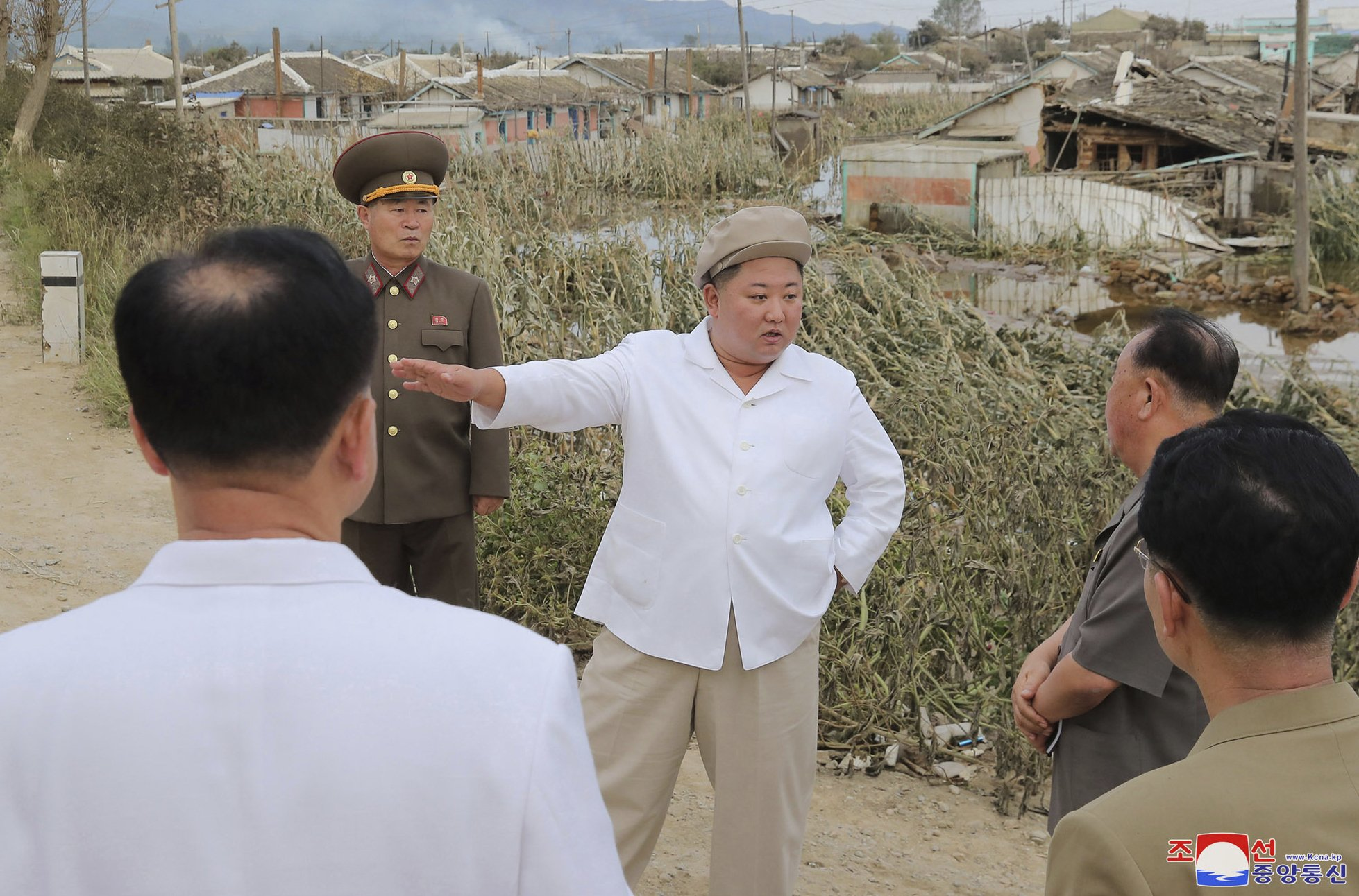 Seeking unity, NKorea's Kim vows to overcome typhoon damage