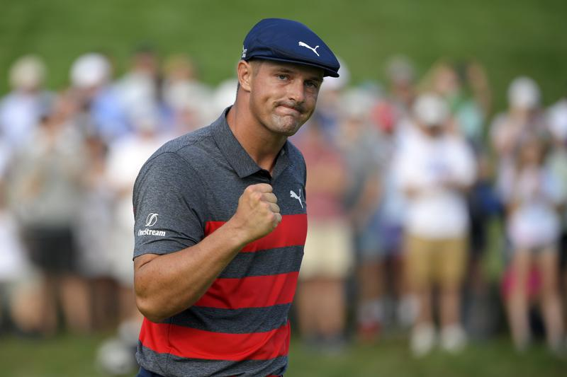 FILE- In this Aug. 29, 2021, file photo, Bryson DeChambeau reacts after sinking his putt on the 16th green during the final round of the BMW Championship golf tournament at Caves Valley Golf Club in Owings Mills, Md. When DeChambeau arrives at Whistling Straits for the Ryder Cup the 6-foot-1, 235-pound disrupter with a world-leading driving average of 323.7 yards, will bring with him an epic amount of baggage. He is in the middle of a months-long feud with one of his teammates, Brooks Koepka, who happens to have three more major titles than DeChambeau.  (AP Photo/Nick Wass, File)