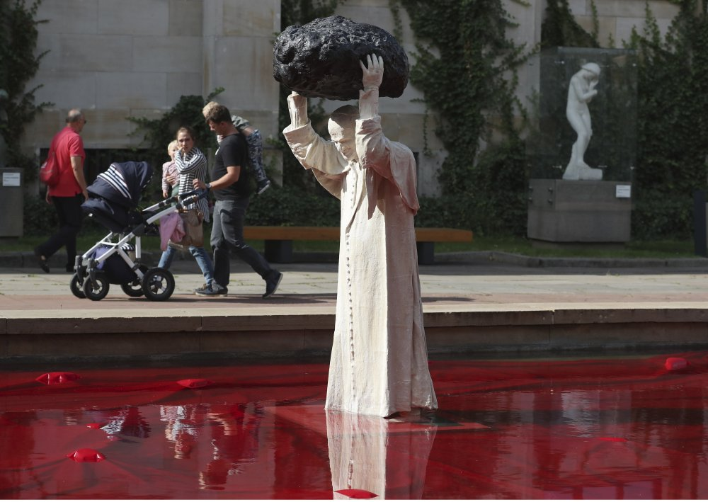 Polish Sculpture of Pope John Paul II Throwing Rock Into Red Water Makes Waves