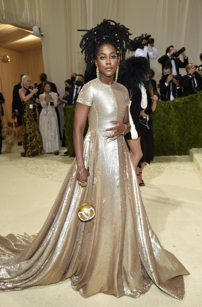 """Tomi Adeyemi attends The Metropolitan Museum of Art's Costume Institute benefit gala celebrating the opening of the """"In America: A Lexicon of Fashion"""" exhibition on Monday, Sept. 13, 2021, in New York. (Photo by Evan Agostini/Invision/AP)"""
