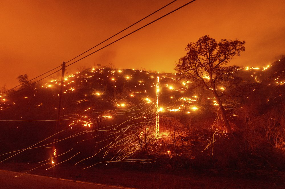 When will it end? California wildfires chase people from homes into smoky air