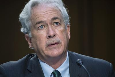 """FILE - In this April 14, 2021 file photo, CIA Director William Burns testifies during a Senate Select Committee on Intelligence hearing about worldwide threats, on Capitol Hill in Washington.  A U.S. intelligence officer suffered symptoms linked to a series of directed-energy attacks known as """"Havana syndrome"""" while traveling with Central Intelligence Agency Director William Burns in India earlier this month. (Saul Loeb/Pool via AP)"""