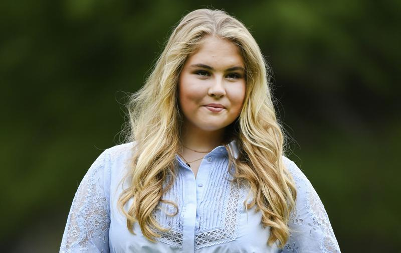 FILE - In this Friday, July 17, 2020 file photo, Netherlands' Princess Amalia poses in the garden of royal palace Huis ten Bosch in The Hague, Netherlands. The heir to the Dutch throne, Princess Amalia, has decided not to accept the allowance -- worth some 1.6 million euros ($1.9 million) per year -- that she is due to receive annually once she turns 18 in December. The princess sent a hand-written letter to Dutch Prime Minister Mark Rutte informing him of her decision on Friday, June 11, 2021. (Piroschka van de Wouw, Pool via AP, File)
